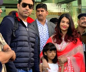 Actors Abhishek Bachchan and Aishwarya Rai Bachchan with their daughter Aaradhya, arrive to attend the pre-wedding functions of Isha Ambani and Anand Piramal in Udaipur, Rajasthan on Dec 8, ...