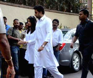 Actors Abhishek Bachchan and Aishwarya Rai Bachchan arrive to pay tributes to Bollywood's veteran action director Veeru Devgan, who passed away, at the Devgan residence in Mumbai on May 27, ...