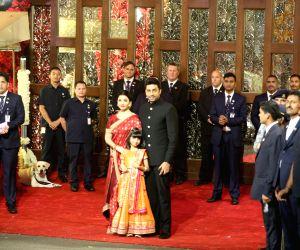 Actors Abhishek Bachchan and Aishwarya Rai with their daughter Aaradhya Bachchan at the wedding ceremony of industrialist Mukesh Ambani's daughter Isha Ambani and Anand Piramal at Antilia in ...