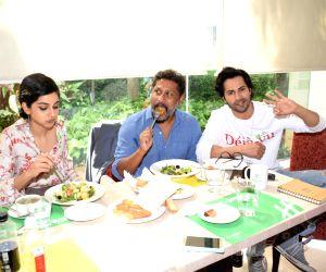 "Actors Banita Sandhu, Varun Dhawan and Director Shoojit Sircar at the promotion of their upcoming film ""October"" in Mumbai on April 9, 2018."
