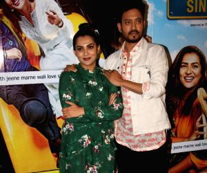 "Actors Irrfan Khan and Parvathy at the screening of film ""Qarib Qarib Singlle"" in Mumbai on Nov 9, 2017."