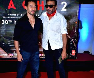 "Actors Jackie Shroff and Tiger Shroff during the special screening of film ""Baaghi 2"" on March 29, 2018."