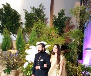 Actors Saif Ali Khan and Kareena Kapoor at the wedding reception of actress Sonam Kapoor and businessman Anand Ahuja in Mumbai, on May 8, 2018. (Photo: IANS)​