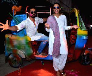"Actors Saqib Saleem and Huma Qureshi at the ""Zoom Holi Party"" in Mumbai on March 2, 2018."