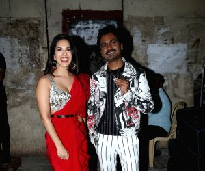 """Actors Sunny Leone and Nawazuddin Siddiqui during the shooting of a song for the upcoming film """"Motichoor Chaknachoor"""" in Mumbai, on Sep 27, 2019."""