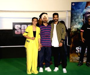 """Actors Taapsee Pannu, Diljit Dosanjh and Angad Bedi at the trailer launch of their upcoming film """"Soorma"""" in Mumbai on June 11, 2018."""