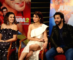 "Actors Varun Dhawan, Tapsee Pannu and Jacqueline Fernandez at a press meet for film ""Judwaa 2"", in New Delhi on Sept. 26, 2017."
