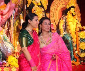 Actorss Kajol and Rani Mukerji during Durga Navami celebrations at a Juhu Durga Puja pandal in Mumbai on Oct 7, 2019. 9Photo: IANS)