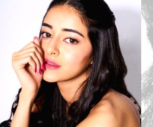 Ananya Pandey graces the cosmopolitan magazine in her yellow-white striped nightwear