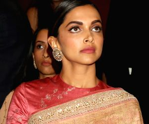 Actress Deepika Padukone looks on as her father Prakash Padukone, an ace badminton player, was felicitated with the Badminton Association of India (BAI) Lifetime Achievement Award by Vice ...