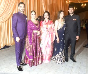 Actress Hema Malini with her daughters Esha Deol and Ahana Deol and her son-in-laws Bharat Takhtani and Vaibhav Vohra at the wedding reception of industrialist Mukesh Ambani's daughter Isha ...