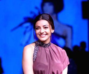 Actress Kajal Aggarwal walks the ramp showcasing fashion designer Nishika Lulla's creation at the Lakme Fashion Week Winter/Festive 2018, in Mumbai on Aug 25, 2018.