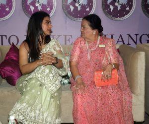 Actress Kajol with Reliance Industries Chairman Mukesh Ambani's mother Kokilaben Ambani at IMC Ladies' Wing - Women Entrepreneurs' Exhibition 2019, in Mumbai on Aug 21, 2019.
