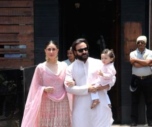 Actress Kareena Kapoor Khan along with her husband Saif Ali Khan and son Taimur during wedding ceremony of Sonam Kapoor and Anand Ahuja in Mumbai on May 8, 2018.