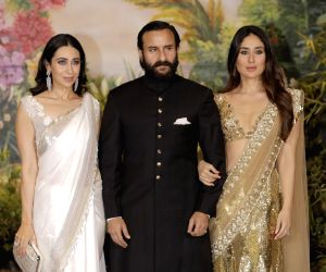 Actress Kareena Kapoor Khan along with his husband Saif Ali Khan and sister Karsima Kapoor at the wedding reception of actress Sonam Kapoor and businessman Anand Ahuja in Mumbai on May 8, ...