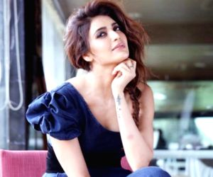 Karishma Tanna channels her playful moods as she dances and works out in this video