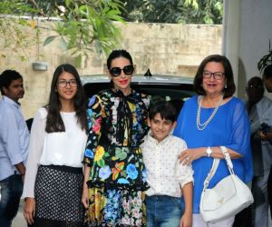 Actress Karisma Kapoor along with her mother Babita Shivdasani and childrens Samiera Kapoor and Kiaan Raj Kapoor arrive to attend Christmas party at late actor Shashi Kapoor's residence in ...