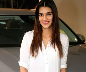 Actress Kriti Sanon poses with her new Audi Q7 in Mumbai on Jan 25, 2018.