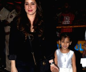 Actress Neelam Kothari and her daughter Ahana Soni arrive at the birthday party of Aaradhya Bachchan, daughter of actors Aishwarya Rai Bachchan and Abhishek Bachchan  in Mumbai, on Nov 17, ...