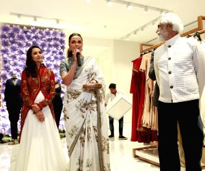 Neha Dhupia, Athiya Shetty and Nimrat Kaur at a multi designer store launch