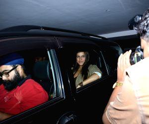 Actress Neha Dhupia seen at filmmaker Karan Johar's residence in Mumbai on June 17, 2019.