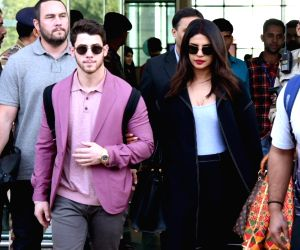 Actress Priyanka Chopra and her husband and American singer Nick Jonas arrive to attend the pre-wedding functions of Isha Ambani and Anand Piramal in Udaipur, Rajasthan on Dec 8, 2018.