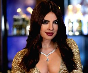 Actress Priyanka Chopra Jonas's wax statue, clad in a low-cut dazzling golden dress, was launched here. (Photo: Twitter/@MadameTussauds)