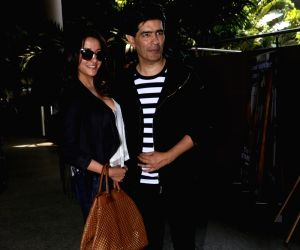 Raima Sen and Manish Malhotra seen at airport