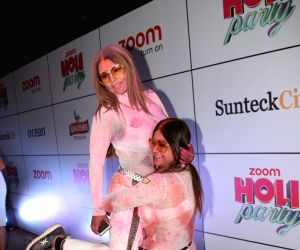 "Actress Rakhi Sawant at the ""Zoom Holi Party"" in Mumbai on March 2, 2018."