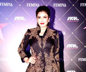 Raveena Tandon makes heads turn as she looks gorgeous in a shimmery silver outfit