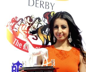 Sanjjanaa unveil the Silver Horse Trophy for the Kingfisher Derby 2015