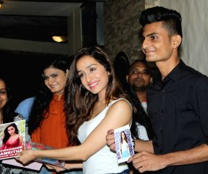 Shraddha Kapoor celebrates success of her films with fans, photographers