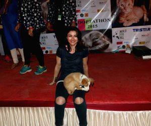 Soha Ali Khan during a animal adoption