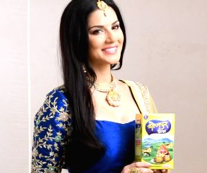 Sunny Leone's smiles are infectious, and playful as she has some fun during work