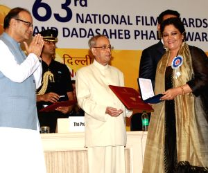 "Actress Tanvi Azmi receives the Best Supporting Actress award for her act in ""Bajirao Mastani"" from President Pranab Mukherjee during the 63rd National Film Awards ceremony at ..."