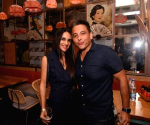 Tara Sharma, Roopak Saluja during the launch of a restaurant