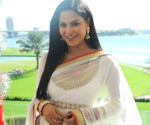 Actress Veena Malik with her husband Asad Bashir during their wedding reception
