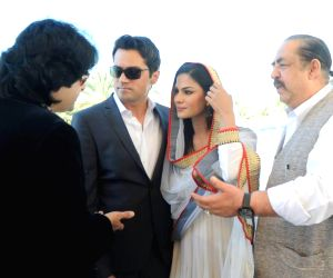 Actress Veena Malik with her husband Asad Bashir during their wedding reception