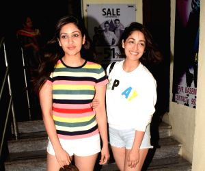 Yami Gautam and Surilie Gautam seen at a cinema theatre