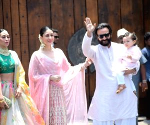 Actresses Karisma Kapoor and Kareena Kapoor Khan along with her husband Saif Ali Khan and son Taimur during wedding ceremony of Sonam Kapoor and Anand Ahuja in Mumbai on May 8, 2018.