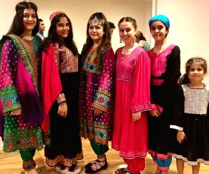 Afghan women protest Taliban's hijab diktat by sharing photos in colourful dresses