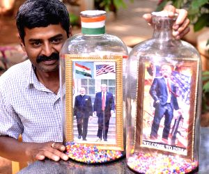 Indian Bottle artist Basavaraj displays frames of Narendra Modi and Donald Trump