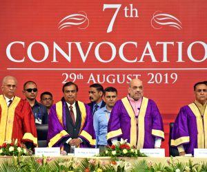 Ahmedabad: Union Home Minister Amit Shah with Gujarat Chief Minister Vijay Rupani, Reliance Industries Chairman Mukesh Ambani and Pandit Deendayal Petroleum University (PDPU) Standing Council Chairman D. Rajagopalan at the 7th Convocation ceremony of
