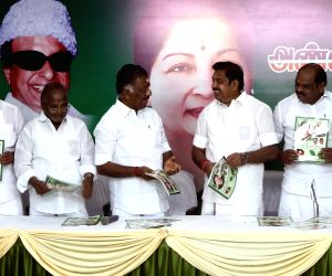 AIADMK leaders - Tamil Nadu Chief Minister Edappadi K. Palaniswami, Deputy Chief Minister O. Panneerselvam and other leaders of the party at the launch of the party's election manifesto ...