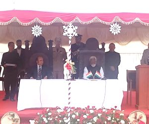 : Aizawl: Mizoram Governor Kummanam Rajasekharan administers the oath of office to Mizo National Front (MNF) leader Zoramthanga as the Chief Minister of Mizoram, in Aizawl on Dec 15, 2018. (Photo: ...