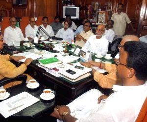 All political party leaders sitting on speaker's chamber during a meeting