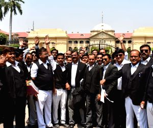 : Allahabad: Lawyers stage a demonstration after a lawyer was shot dead in broad daylight in Allahabad on 10th May, 2018; ouside Allahabad High Court on May 11, 2018. The lawyer, Rajesh Srivastava, ...