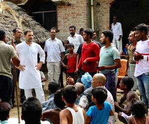 Amethi: Congress President Rahul Gandhi interacts with the villagers during his visit to Umradeeh village in Amethi, Uttar Pradesh on July 4, 2018. (Photo: IANS/Twitter/@INCIndia)