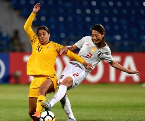 AMMAN, April 21, 2018 - Japan's Rumi Utsugi (R) vies with Samantha Kerr of Australia during the AFC Women's Asian Cup Finals match in Amman, Jordan, on April 20, 2018. Japan claimed the title by ...