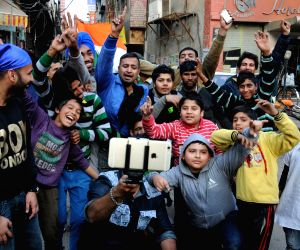 People celebrate India's victory in a World Cup match against Pak